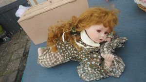 Red head porcelain doll laying down for Sale in North Charleston, SC