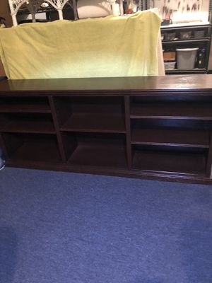 Shelf unit. Yes, your new 70 inch tv will fit. 179.99 for Sale in SEATTLE, WA