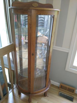Beautiful round glass front curio with mirror back and glass shelves for sale for Sale in St. Louis, MO