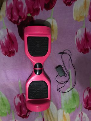 Pink hoverboard plus charger for Sale in Pasadena, TX