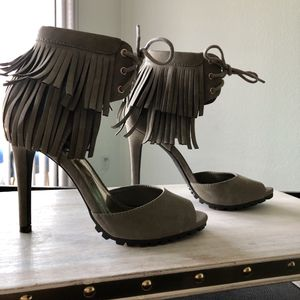 New JLo grey faux suede stilettos with fringe and tie up ankle strap for Sale in Austin, TX