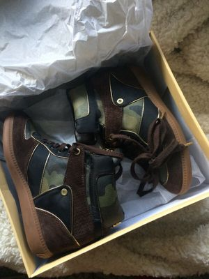 Authentic new condition Michael Kors heeled sneakers for Sale in Tampa, FL