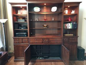 Wall unit bookcase with hideaway tv system and more!!!!! for Sale in Ashburn, VA