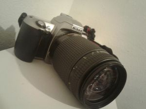 Nikon camera, F65 , with lenses , a bag ,and a instuctions manual.Not a digital camera. for Sale in Riverside, CA