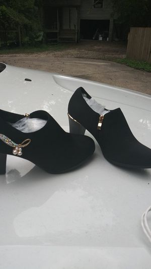 Women's booties boots size 7 and 1/2 brand new never been worn black for Sale in Spring, TX