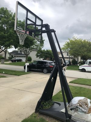 Spalding beast 60inch glass basketball hoop for Sale in Schaumburg, IL