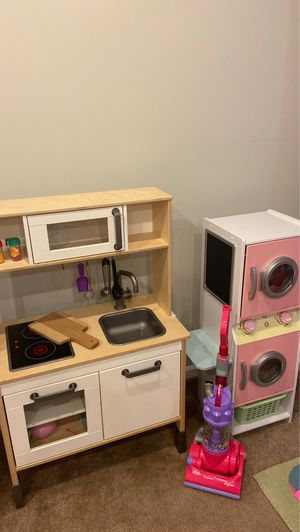IKEA play kitchen, Dyson Vacuum, Washer Dryer and doll shopping cart for Sale in NO POTOMAC, MD