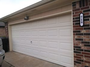 16 by 7 cream garage door and motor and accessories and key Excellent condition/no dents... selling bc getting a new style for Sale in Port Neches, TX