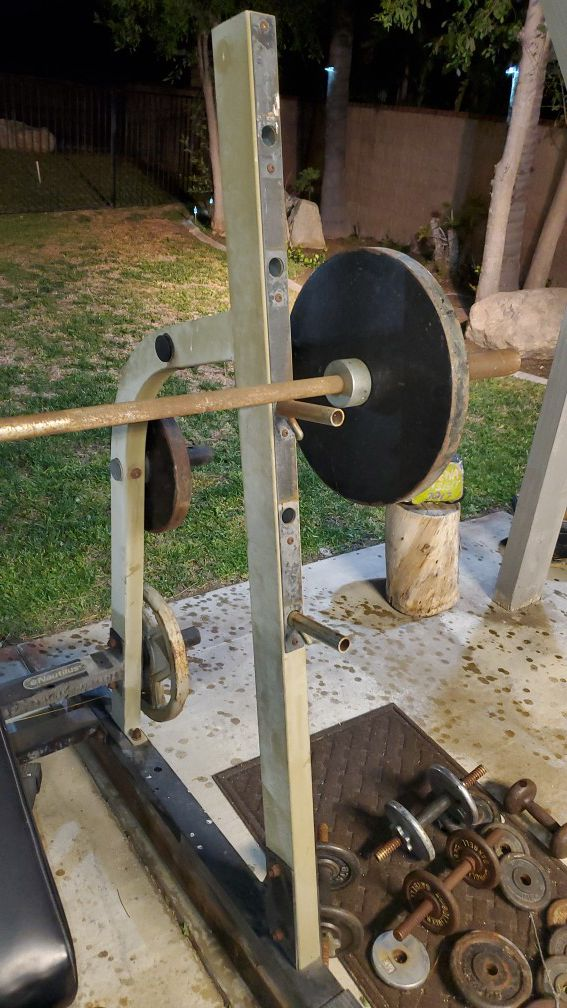Nautilus half squat rack weight system 235 lbs Olympic bar curl bar and 120 lbs of free weights. Will deliver. Weekends only.