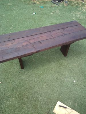 BEAUTIFUL RUSTIC COFFEE TABLE 4FT LONG 16 1/2 WIDE AND BOUT 18IN TALL $60 FIRM ITS BEEN STAINED WITH A GORGEOUS RED MAHOGANY COLOR for Sale in Phoenix, AZ