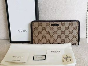 New GUCCI Canvas Monogram Brown Leather Trim Zip Around Clutch Wallet for Sale in Barrington, IL