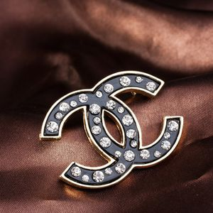 Chanel Lady's Brooch with White Rhinestones. for Sale in Arlington, TX