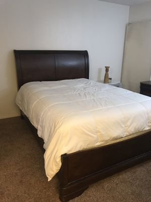 Dark wood sleigh bed frame and night stands. for Sale in Lompoc, CA