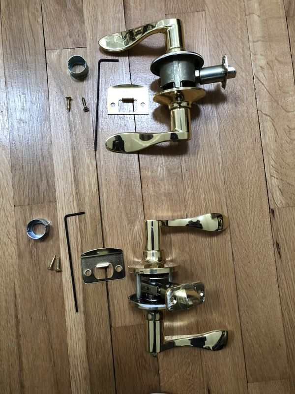 Kwikset brass door knobs (qty 8) and one unknown