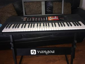 Yamaha piano keyboard with stand & new batteries for Sale in Placentia, CA