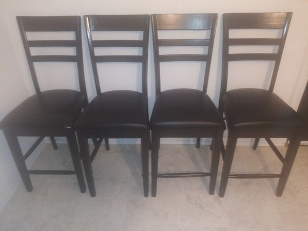 Black leather seated tall bar chairs