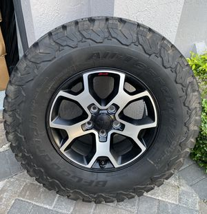 Jeep Wrangler Rubicon factory wheels and tires . for Sale in Miami, FL