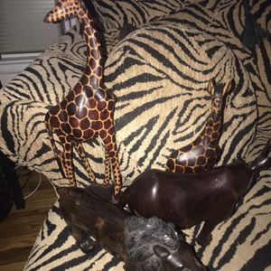 Solid teak straight from Africa 3-D line and rhino all hand carved by natives to giraffes for Sale in Long Branch, NJ
