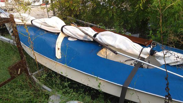 Sunfish sailboat and trailer