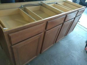 Brown solid wood kitchen island cabinets for Sale in Glendale, AZ