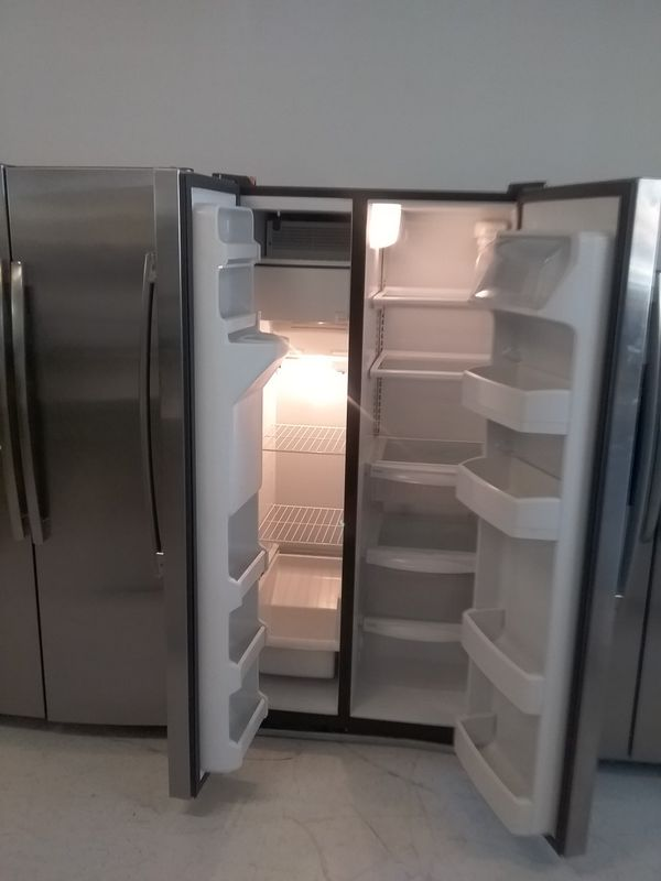 I kenmore ge side by side stainless steel refrigerator used good condition 90days warranty