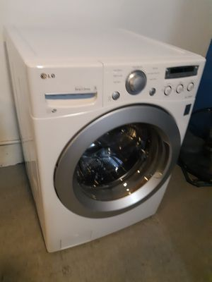 LG FRONT LOAD WASHER WORKING PERFECTLY 4 MONTHS WARRANTY for Sale in Baltimore, MD
