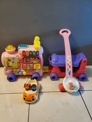 VTECH TRAIN, FISHER PRICE POPPER AND A TEAM UMISUMI CAR TOYS for Sale in Miami, FL