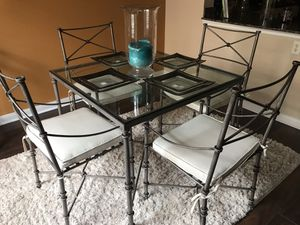 Pier One Rod iron and glass top table with 4 matching chairs . matching rod iton coffee table and end table. 2 lamps for Sale in Carrollton, TX