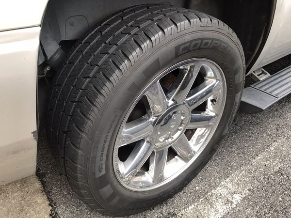 4 great tires with the rims for a Yukon