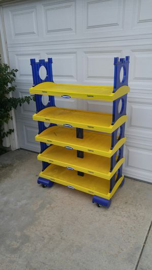 Yellow and blue plastic shelf for Sale in Temecula, CA