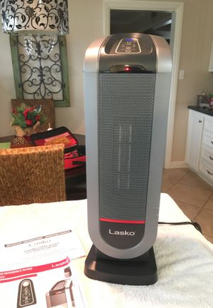 Lasko ceramic tower space heater 1500 watts of heating power remote control for Sale in Downey, CA