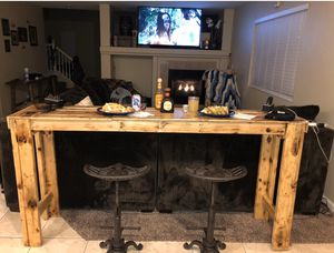Pine bar and wrought iron adjustable tractor seat barstools!!! Pub table set! for Sale in North Las Vegas, NV