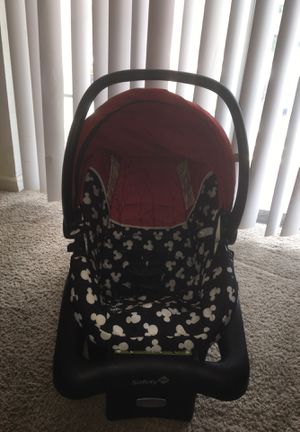 Mickey Mouse car seat with base. Comes with matching stroller for Sale in Greenville, SC