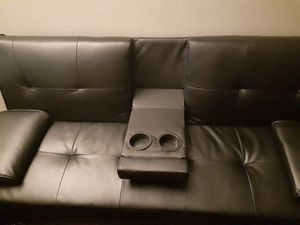 Two black leather futons with cup holders for Sale in Las Vegas, NV