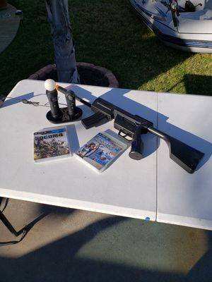 Ps3 riffle and action wand with 2 games for Sale in Moreno Valley, CA