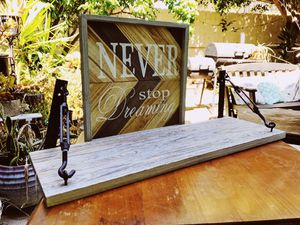 "Rustic industrial gray shelf and sign. Shelf has cool iron hardware brackets. Sign has chevron background and reads ""never stop dreaming"". Cute to for Sale in Newport Beach, CA"