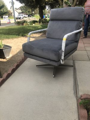 Brand new grey velvet stainless steel arm swivel chair. Retails for over $500 for Sale in Fowler, CA