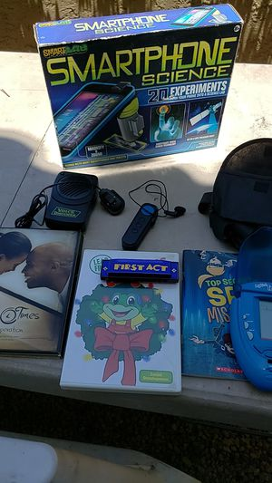 $70 Worth of NEW Toys, books, DVD's, Harmonica, voice changing gadget and light up Tetris game for Sale in Scottsdale, AZ