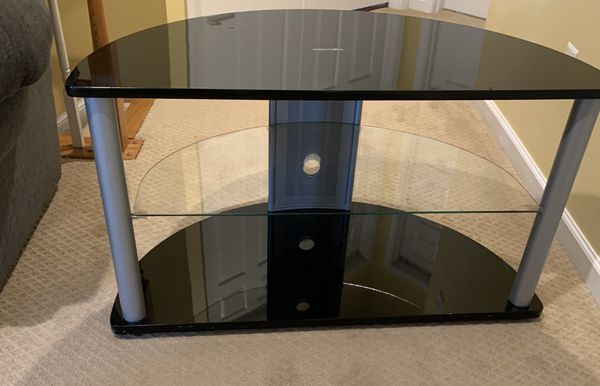 Black Tv stand with three shelfs semi circle Excellent condition
