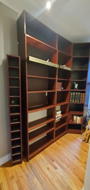3 Ikea shelves 8 feet tall with 2 feet extensions on top for each shelf for Sale in New York, NY