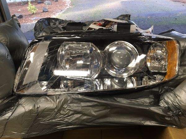 New Audi A4 Quattro Headlights/ headlamps left and right