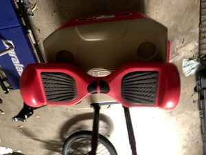 Red hoverboard with charger for Sale in Turlock, CA