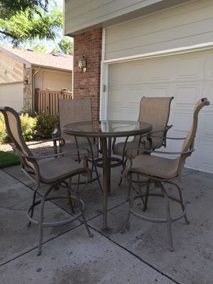 Hampton Bay 5 piece bar style patio set and chaise lounge. Table top has cut out for umbrella. Excellent condition. for Sale in Littleton, CO