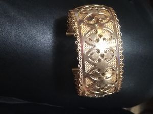 Vintage gold tone cuff designer cuff bracelet for Sale in Hobart, IN