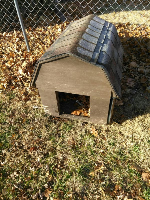 Nice wooden dog house with new shingles