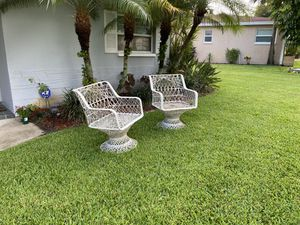 Patio chairs, hard material don't know what it is but they're in very good condition could use a bath for Sale in Palm Harbor, FL