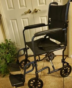"""DRIVE TRANSPORT WHEELCHAIR. seat width 19"""" , arm rest 29"""" high , handles for pushing chair 39"""" High. for Sale in Chula Vista,  CA"""