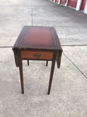 Antique end table with leather top, sides raise up and small drawer for remotes etc... for Sale in Austin, TX