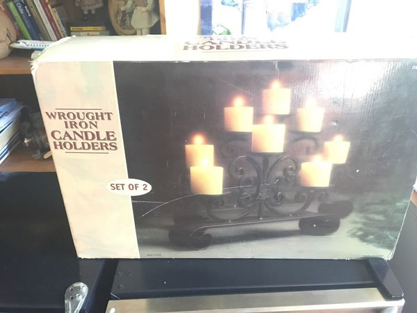 """Wrought iron candle holders set of 2 Large holder 15""""H 24W5.5D. Small holder 11""""H20""""W 4.5D. $50"""