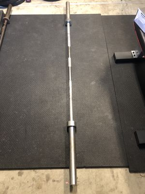 45lbs Barbell(Chinese) and 2- 35lbs metal plates for sale. for Sale in Pico Rivera, CA